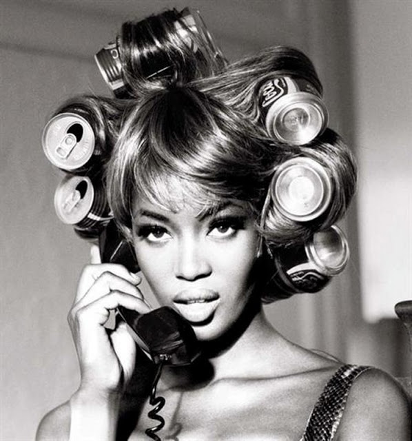 Naomi Campbell with Coca-Cola rollers, photographed by Ellen von Unwerth, 1991